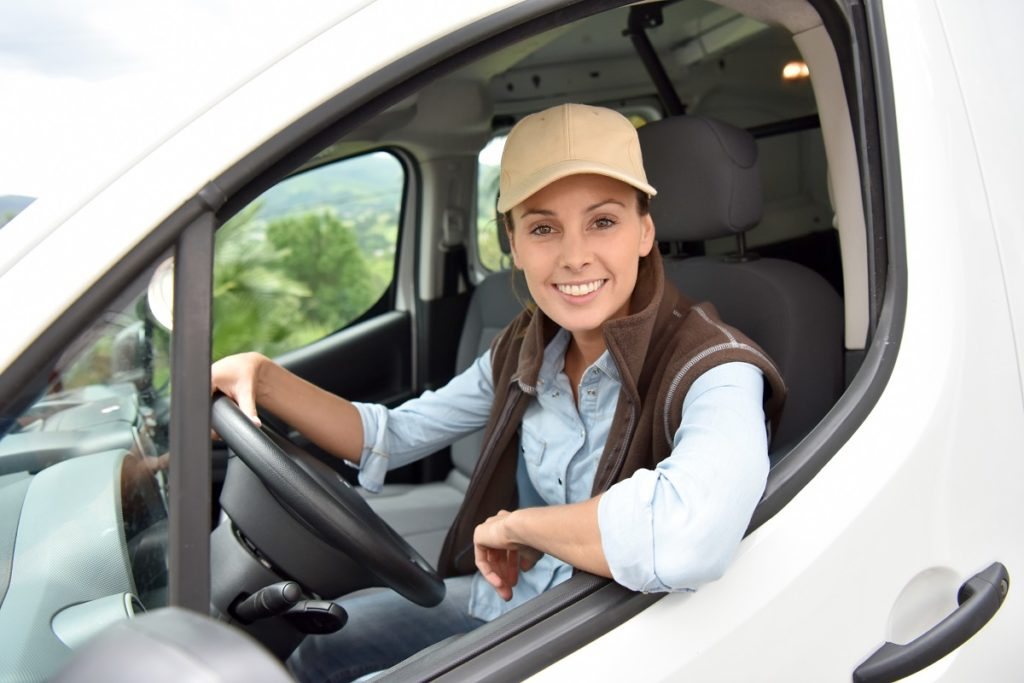 Woman driving a sprinter van