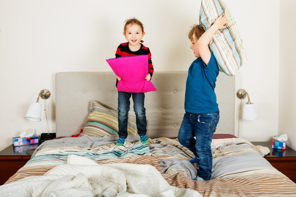children having a pillow fight