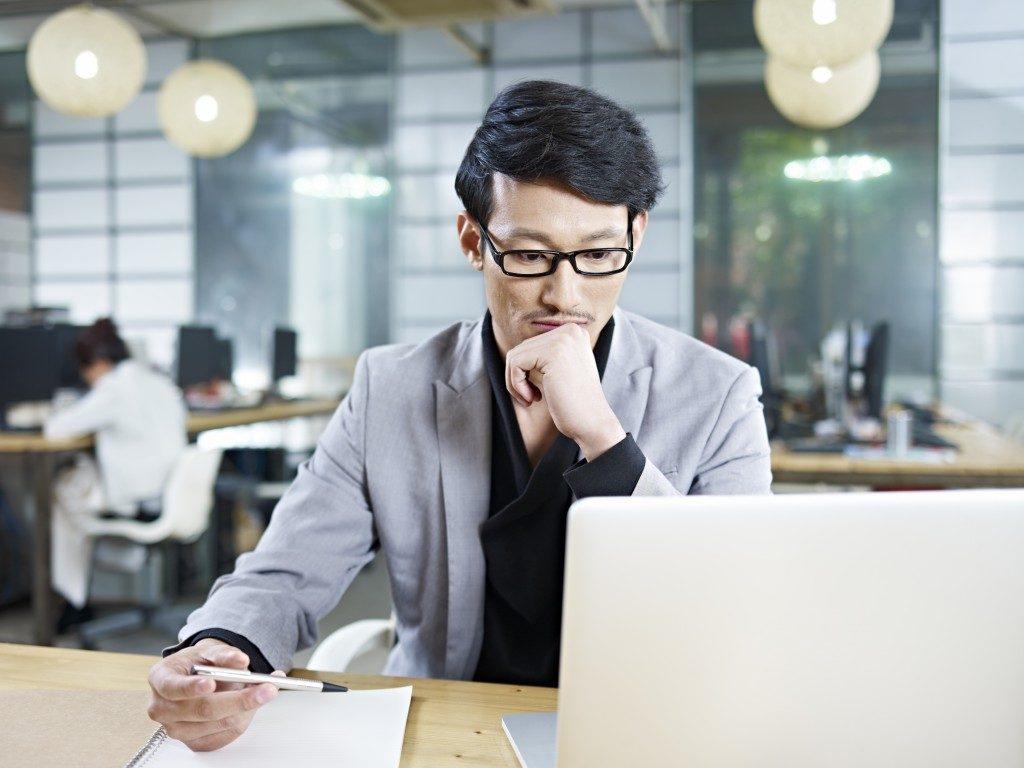 entrepreneur working on his laptop