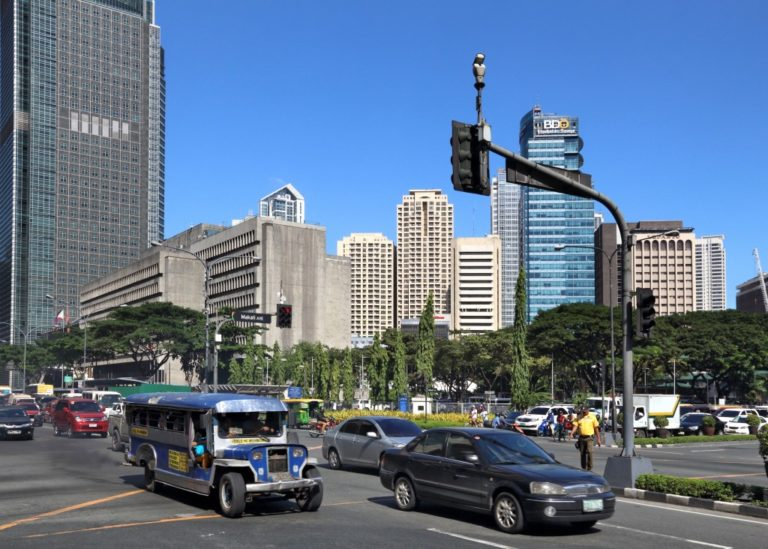 Cars and jeepney in makati