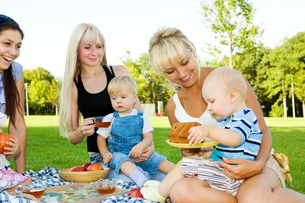 mothers and their babies having a picnic
