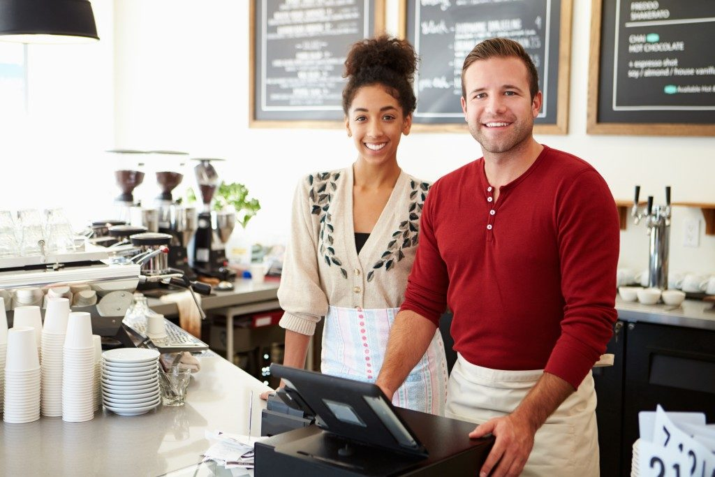 two people in front of the counter