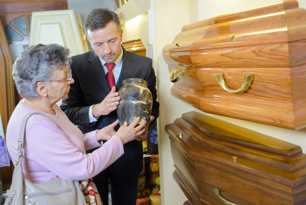 old lady choosing a coffin