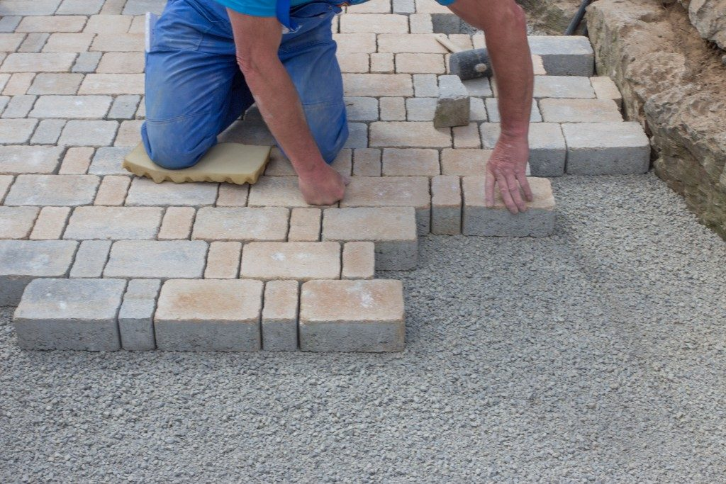 Adding pavement stones in the garden as pathway