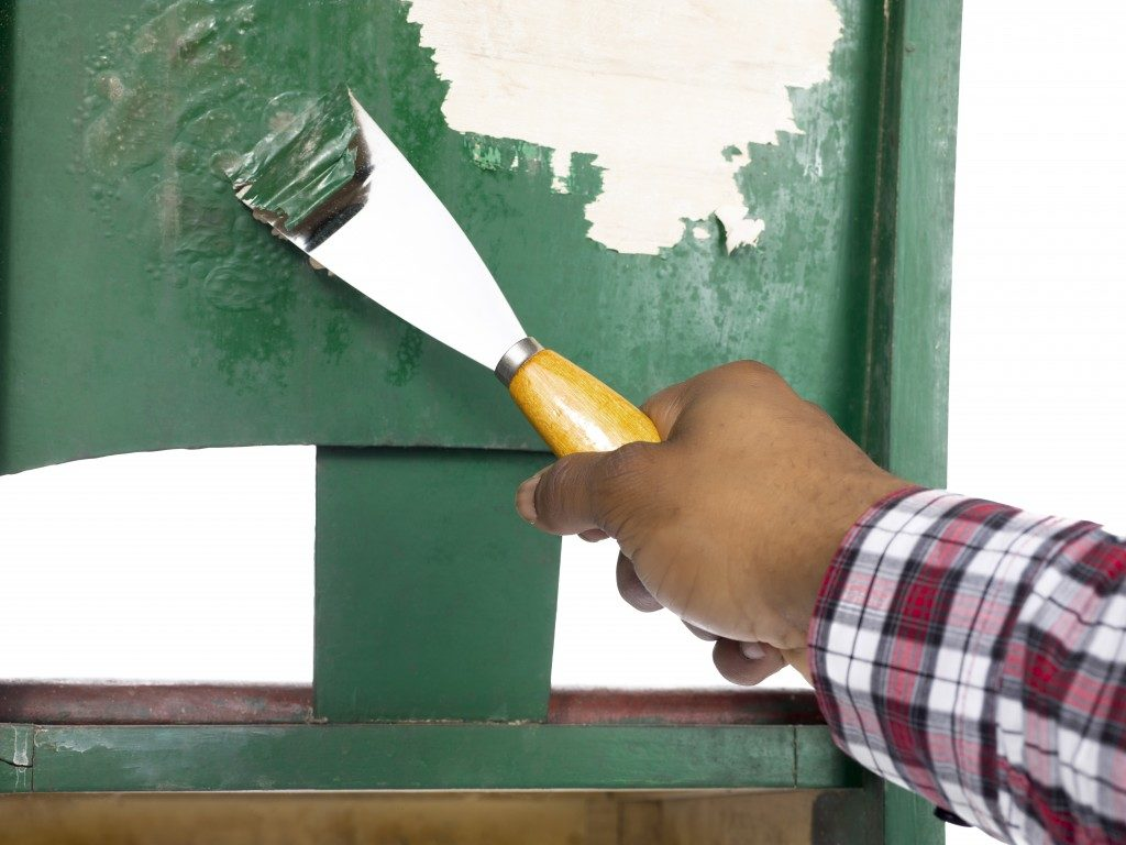 scraping old green paint