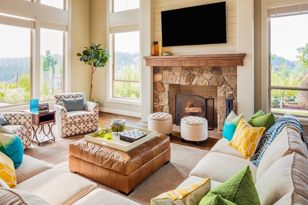 cottage themed living room with fireplace
