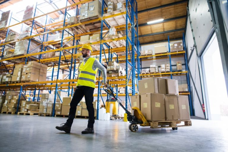 Man in a logistics warehouse