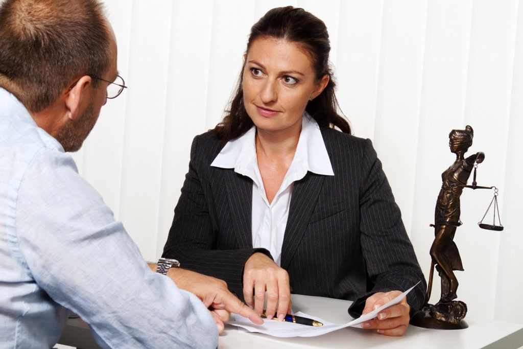 tax lawyer with a client in the office