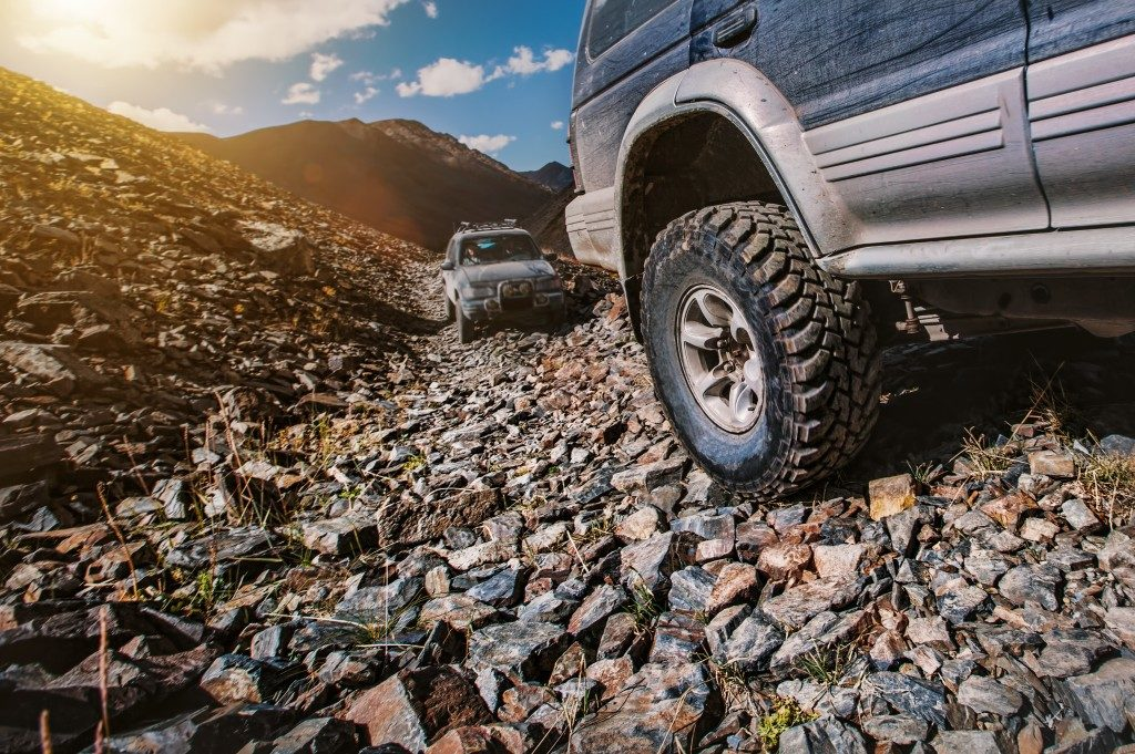 off road vehicles on a rocky path