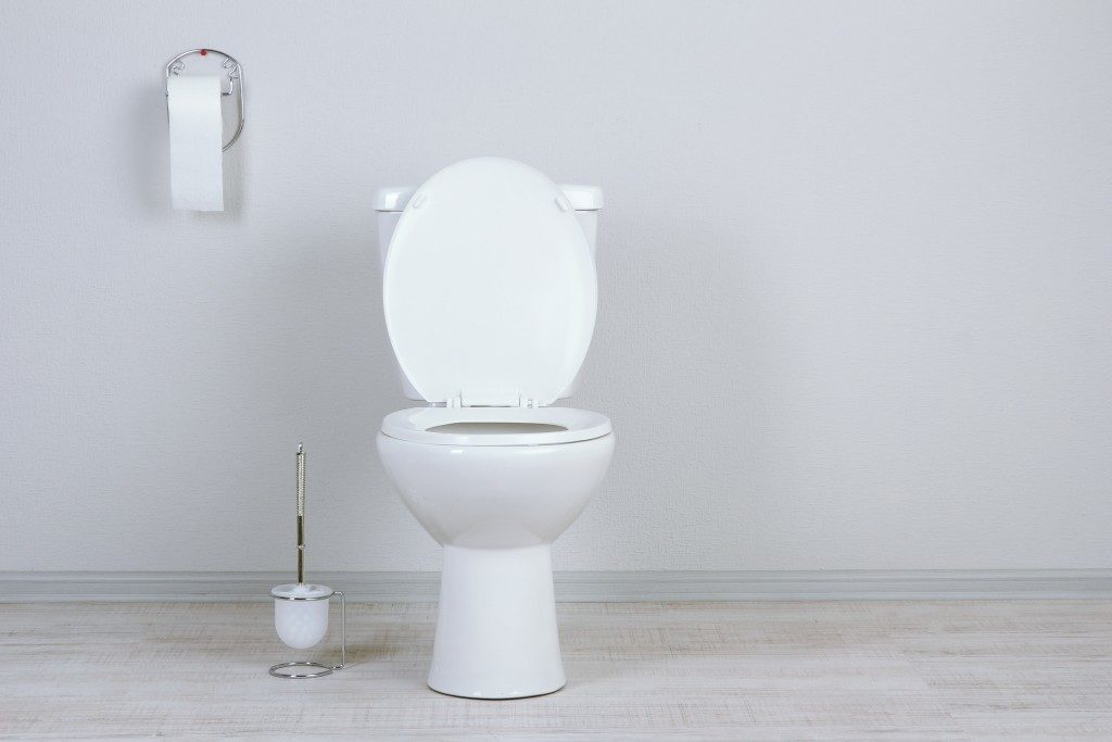 White toilet bowl in a bathroom