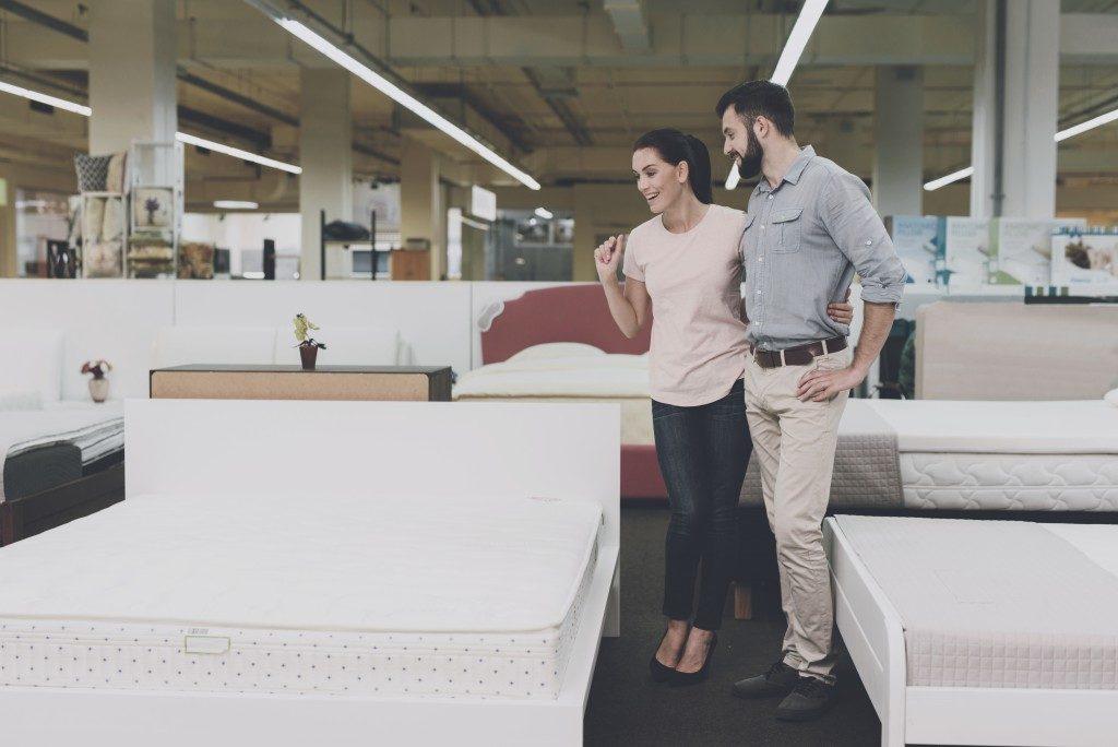 Couple choosing mattresses
