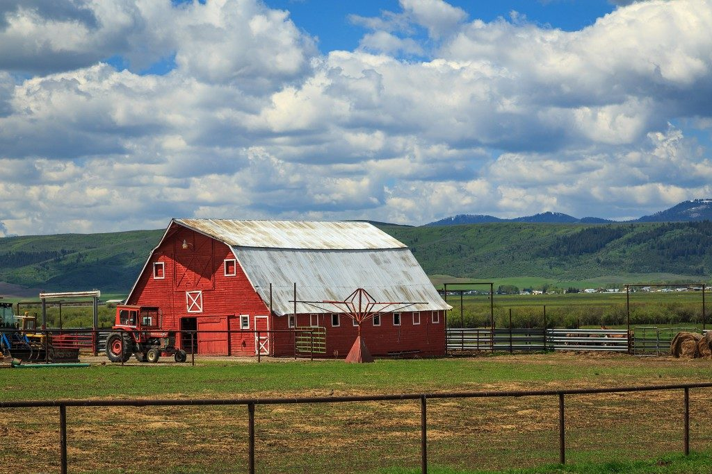 red barn surrounded by mountains