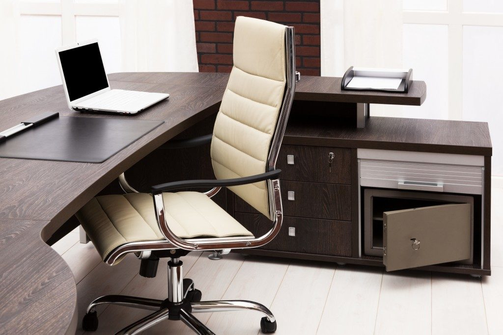 workplace with wooden desk and drawer