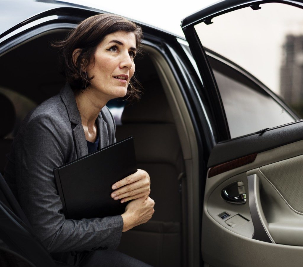 businesswoman walking out of a car
