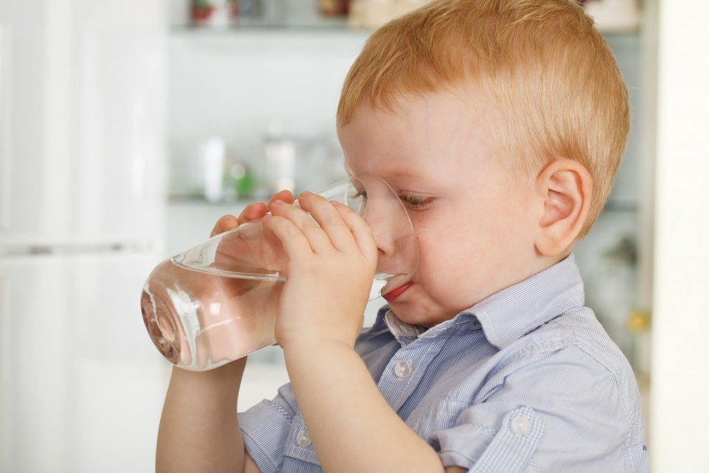 Boy drinking water from a glass