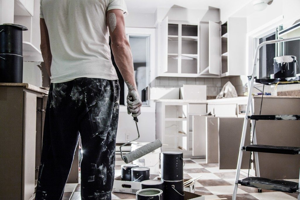 man painting his kitchen