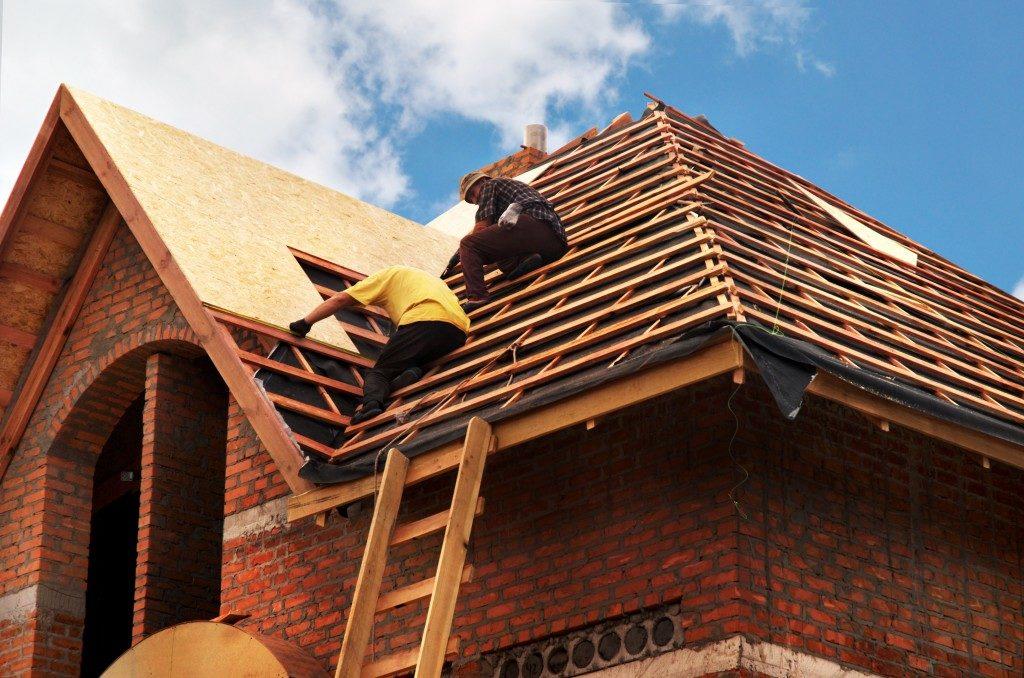 men fixing the roof
