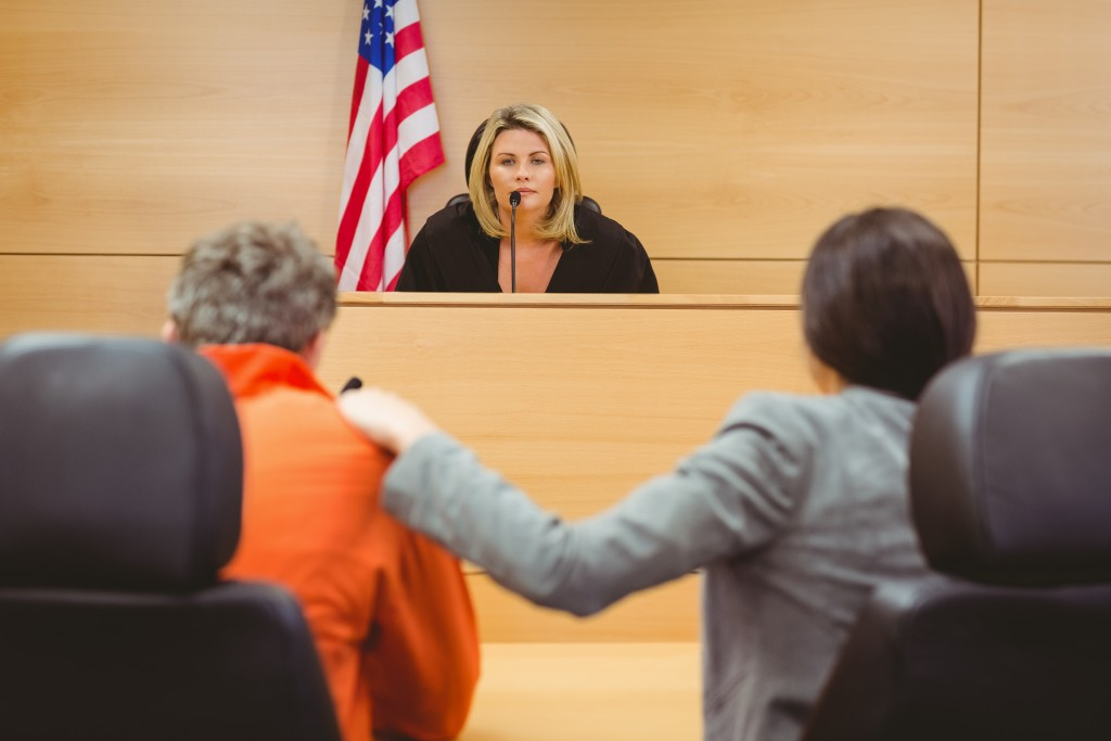 people at a court room hearing