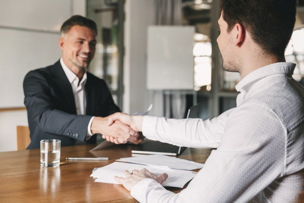 HR shaking hands with an applicant