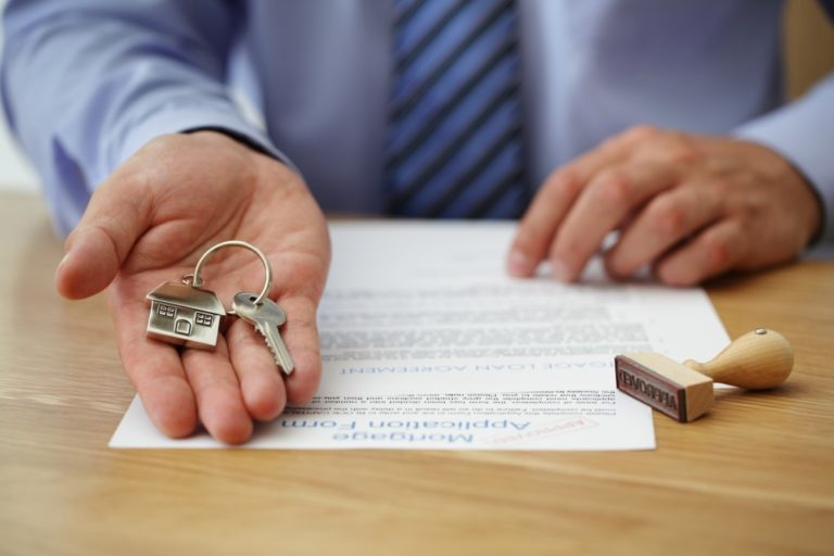 mortgage loan contract with house keys