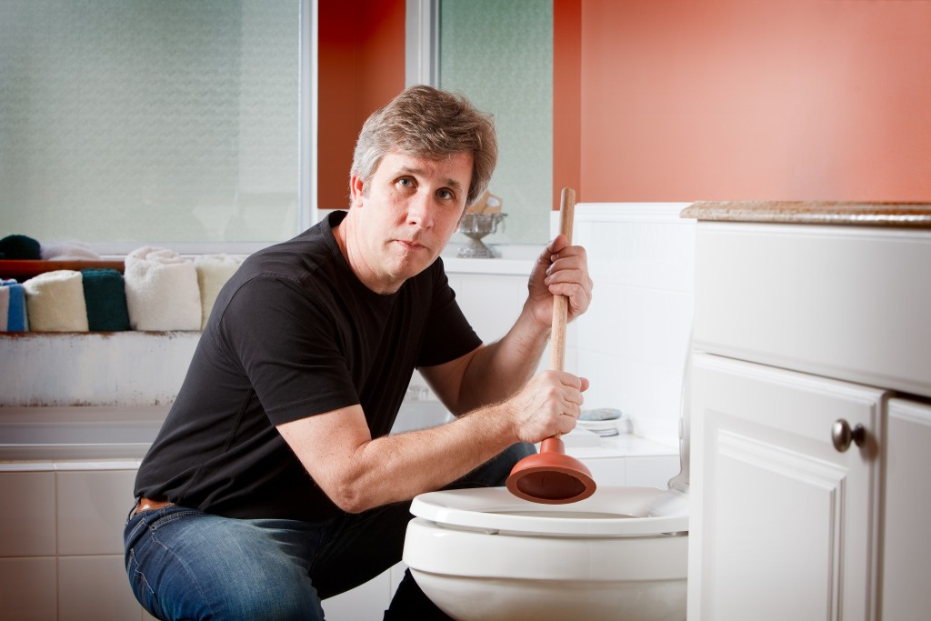 a man using a plunger