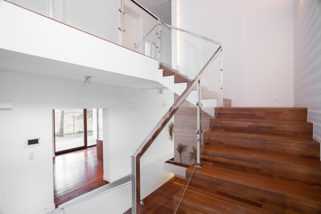 solid wooden stairs with elegant glass balustrade