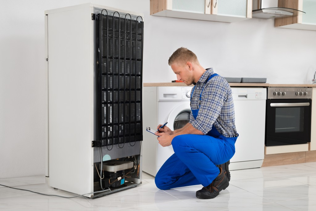 contractor looking at a refrigerator