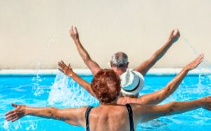 couple of seniors swimming