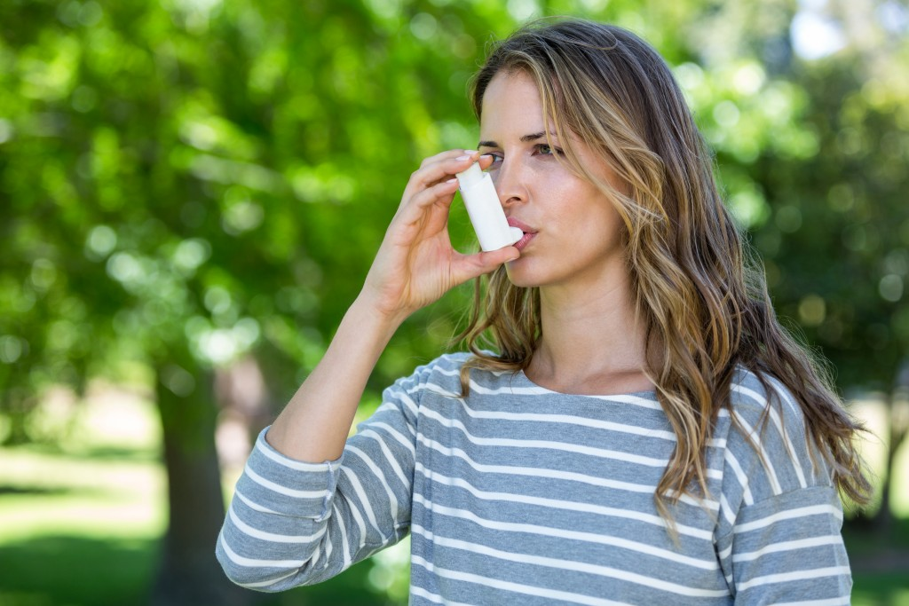 Female using inhaler
