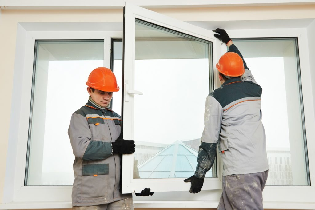 two men installing window glasses