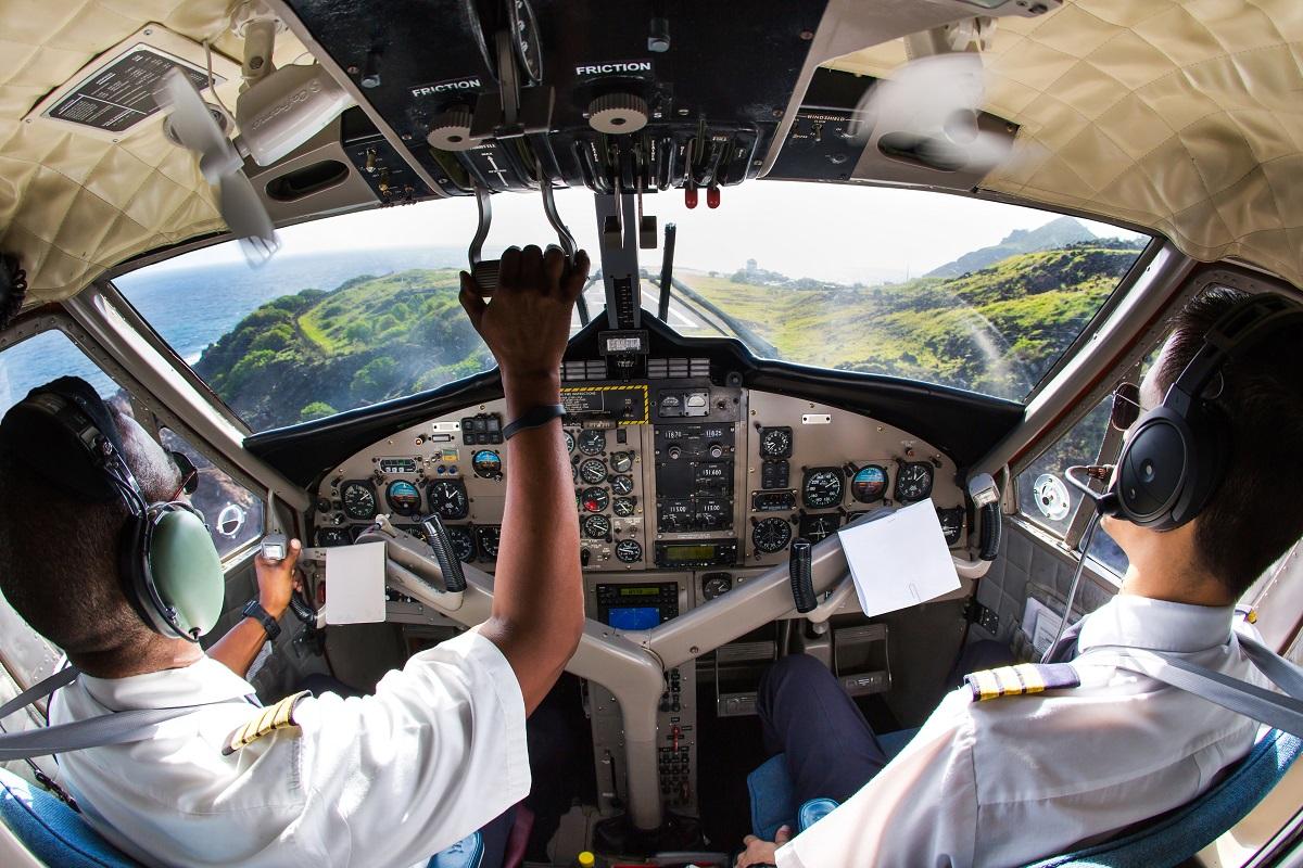 pilots managing the aircraft