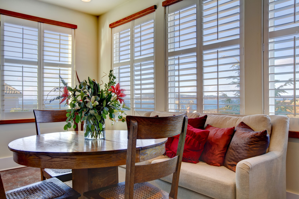 dining room with windows and blinds
