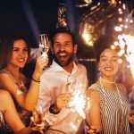 partygoers holding sparklers
